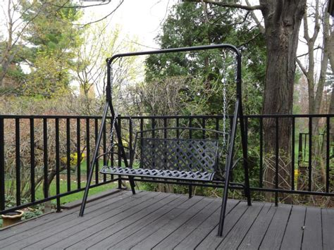 exterior wrought iron porch swings with a frame using