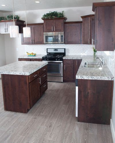The gray countertops match the metal color which makes this room has a good color combination. Image result for cherry cabinets grey floor | Kitchen ...