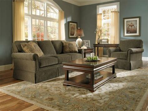living room paint ideas with olive green couches olive green upholstered sofa by