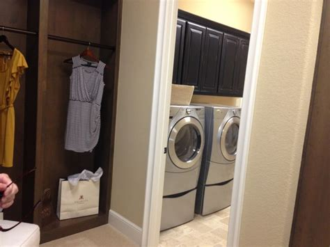 laundry room attached to master closet home