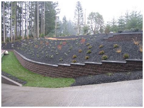 retaining wall on steep slope steep slope retaining wall outdoor spaces pinterest