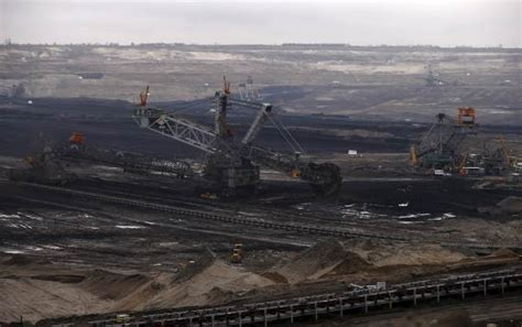 Time difference between belchatow and other cities. The Belchatow Coal Mine, the biggest opencast mine of brown coal in Poland, is seen outside ...
