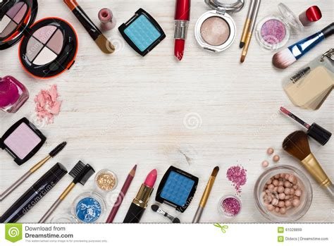 makeup products  wooden background  copy space