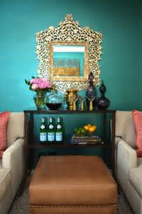 dalliance design living rooms teal walls teal living room walls gold mirror mini bar