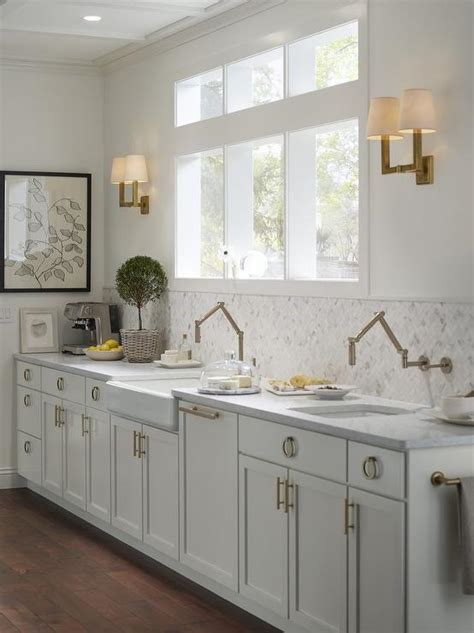 Extra Light Gray Kitchen Cabinets with Brass Ring Hardware