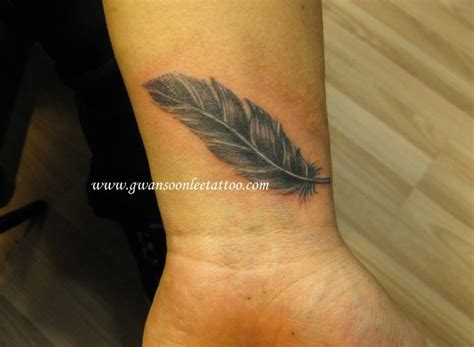 feather tattoo design  wrist tattoos pinterest