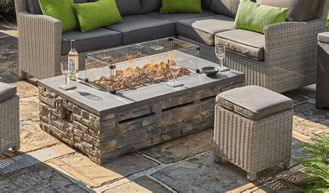 This stylishly designed propane fire pit coffee table also comes with two corner chairs, two middle chairs, and a pair of oversize make your patio the place to be by gathering everyone around the olson concrete fire pit table. Kettler Kalos Stone Fire Pit Coffee Table - £839 | Garden4Less UK Shop