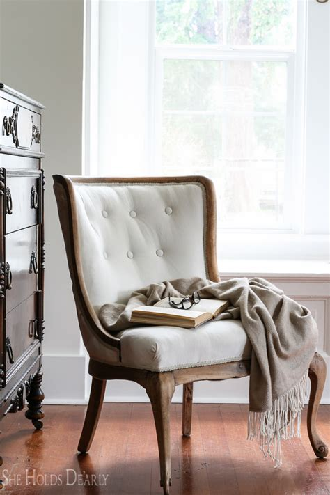 Getting A Chair Reupholstered by Reupholstering An Antique Chair She Holds Dearly