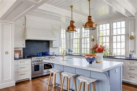 cornflower blue center island  copper industrial pendants cottage kitchen