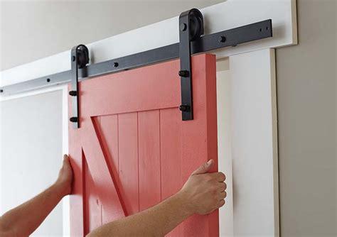 installing barn door hardware easy barn door paint and install the home depot