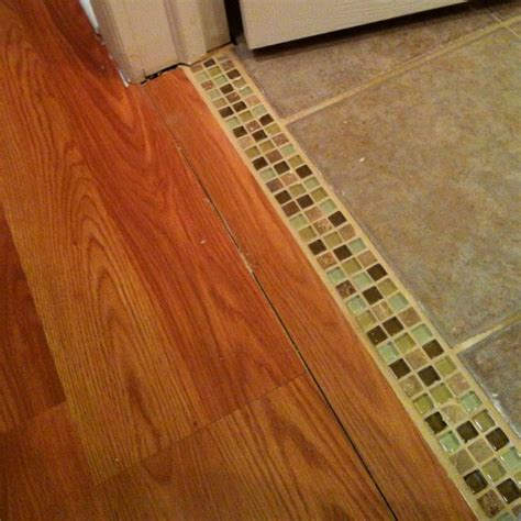 creative tile moulding trim between tile bathroom and