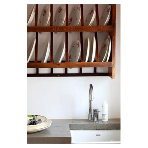 gap interiors wall mounted plate rack  modern kitchen picture library specialising