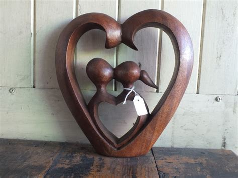 lovers statues carved  wood