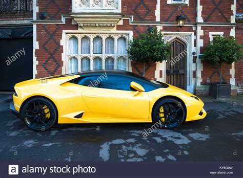The House That Parks A Lamborghini In The Living by Yellow House And Yellow Car Stock Photos Yellow House