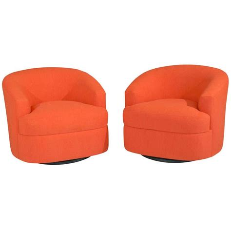 pair of orange swivel chairs at 1stdibs