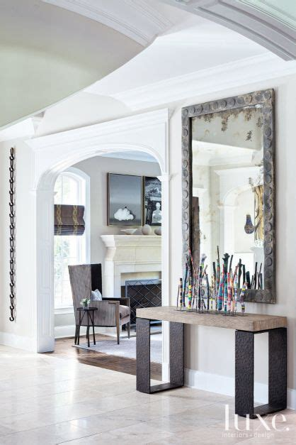 contemporary neutral foyer with industrial mirror luxe