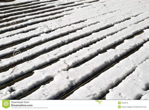Melt For Wood Deck by Wood Deck In Snow Royalty Free Stock Images Image 3945319