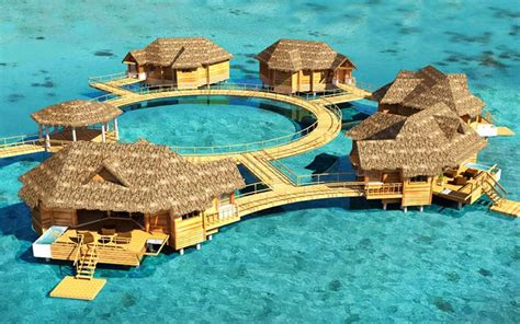 The Caribbean's First Over Water Bungalows   Latitudes Travel