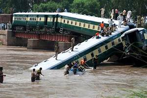 Train falls into canal in deadly bridge collapse
