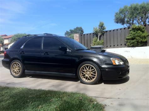 black subaru gold rims dipped the stock wheels subaru