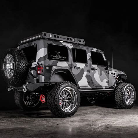 custom camouflaged lifted jeep  road wheels