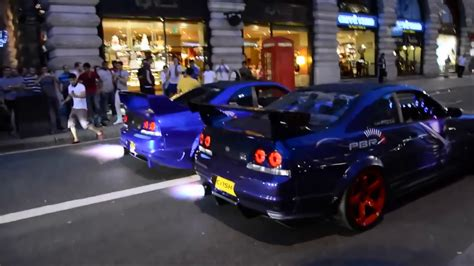 Gtr Shooting Flames Wallpaper by Two Nissan Gtr R33 Skylines Revving And Shooting Flames In