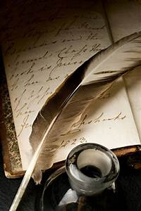 feather pen and inkwell with old handwritten journal ...