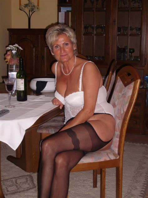 Mature Wife In Lingerie Has A Glass Of Wine