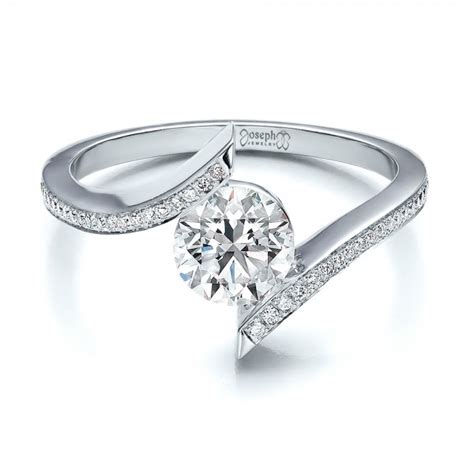 contemporary tension set pave engagement ring