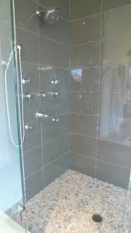 large grey glass tiles on wall smaller mosaic like tiles on floor master bath remodel