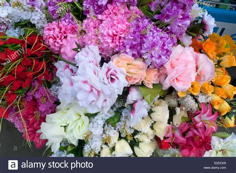 artificial fabric flowers for sale at an african stall in ridley road stock photo royalty free