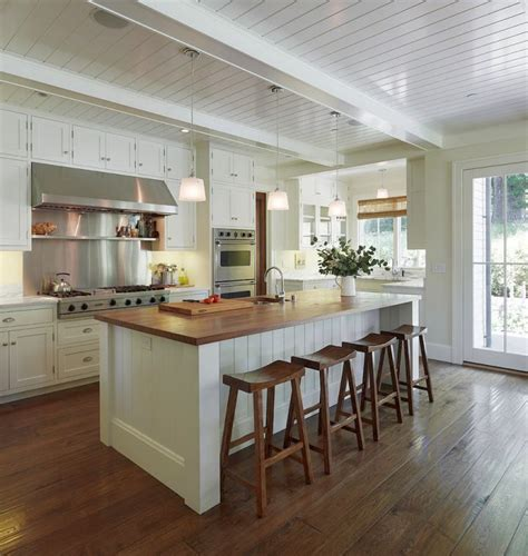 exposed beam tongue  grove ceiling   white kitchen  timber benchtop  timber