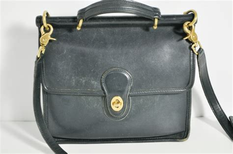 vintage coach black willis leather flap twist lock cross