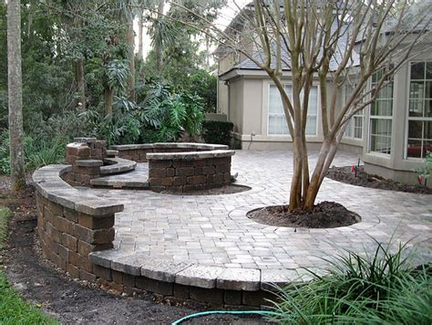 retaining wall patio design patio seating ideas brick paver patio custom firepit retaining wall french doors for