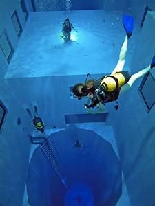 Design Taxi Logo World S Deepest Swimming Pool Designtaxi Com