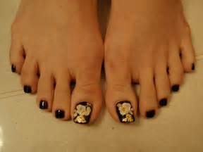 D nail art design with flower over black toenails