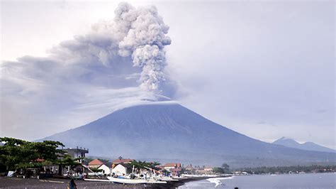 bali airport reopens  volcano eruption