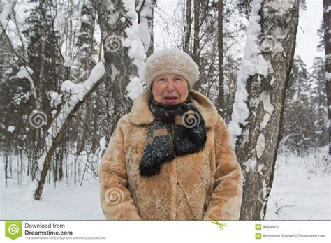 Old Lady Fur Coat And Hat Standing In Cold Winter Snow
