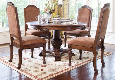 shore pedestal dining table and 4 upholstered