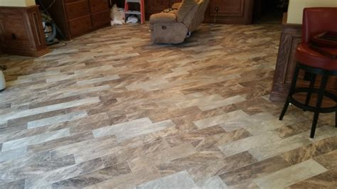 tile flooring northwest arkansas wood grain tile on diagonal in springdale home modern basement other by carpet one floor