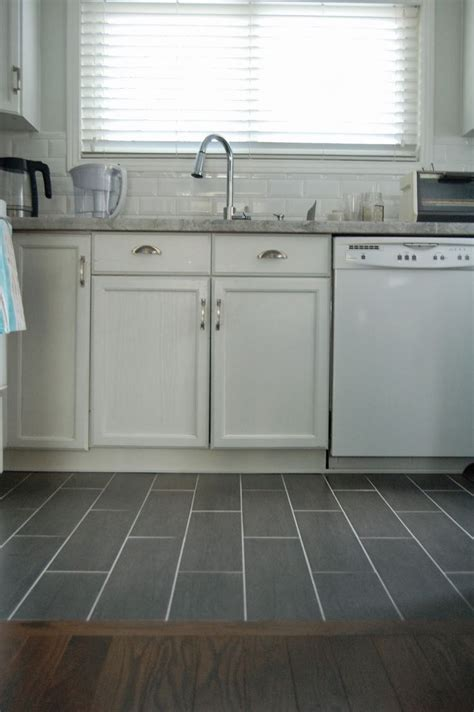 kitchen wood tile floor wood floor to tile transition kitchen remodel pinterest grey black tiles and to the wall