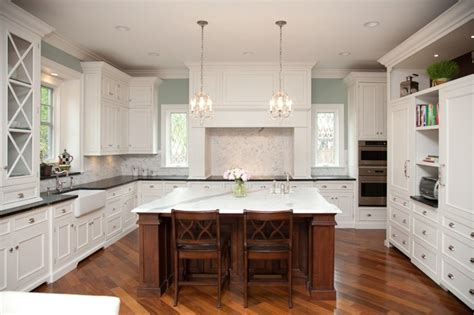 white kitchen cabinets with cherry wood floors oakley home builders 2205