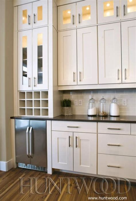 white shaker cabinets  top cabinets glass doors