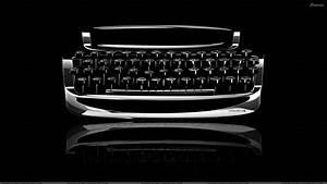 Typewriter Closeup On Black Background Wallpaper