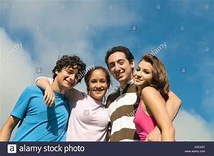 Group of 4 friends under blue sky Stock Photo, Royalty ...