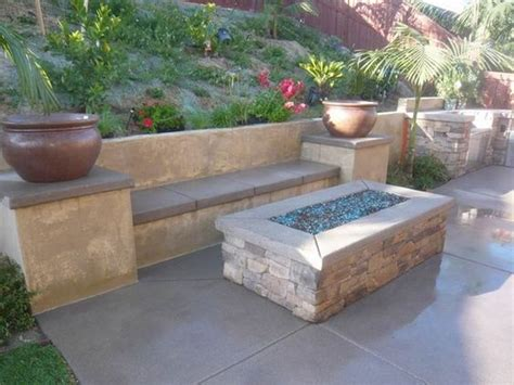 built in outdoor pit what more can you ask for rectangular fire pit built in bench seating and planters on top of
