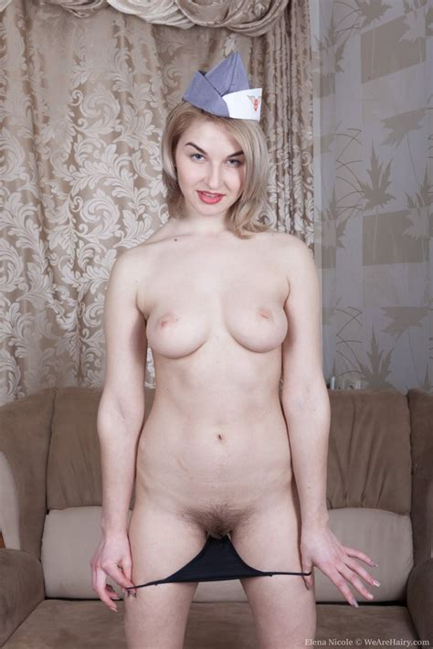Hairy Flight Attendant Showing Her Pink Pussy