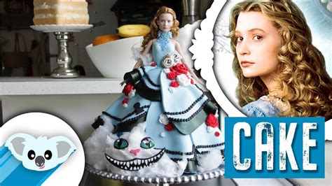 alice  wonderland doll cake    glass
