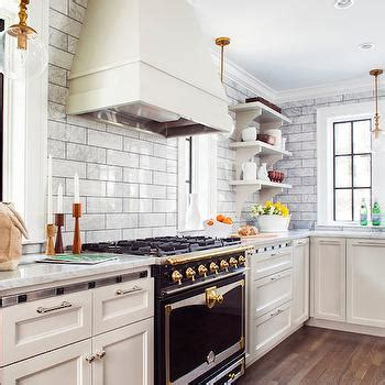 white kitchen cabinets  white marble countertops  backsplash transitional kitchen