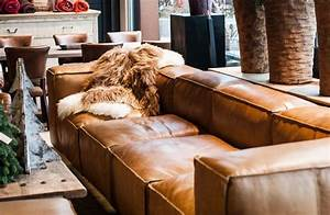 Living room design with cognac brown leather sofa